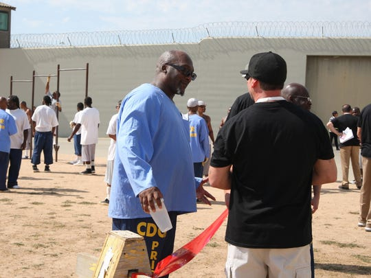 Inmate James Lee speaks with fellowship volunteers during Operation Starting Line at Salinas Valley State Prison on Friday.