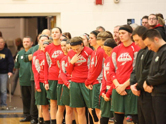 A moment of silence was observed in memory of Oak Harbor