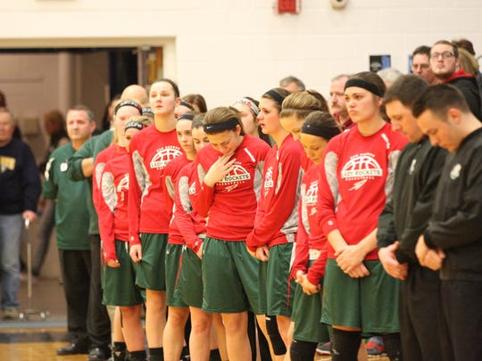 A moment of silence was observed in memory of Oak Harbor coach Ralph Mills in Woodmore's gym Saturday.