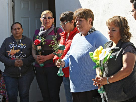 Parents of the victims killed in the Jan. 30, 2010, Villas de Salvárcar massacre in southeast Juárez on Wednesday hold flowers in memory of their children. They were given tickets to watch Pope Francis celebrate Mass on Feb. 17.
