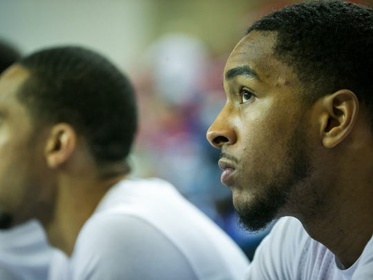 Former University of Delaware basketball player, Davon Usher, now in the NBA D-League with the Maine Red Claws, sits on the bench as they play against the Delaware 87ers at the Bob Carpenter Center.