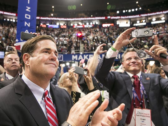 Gov. Doug Ducey (left) cheers with Robert Graham, chairman