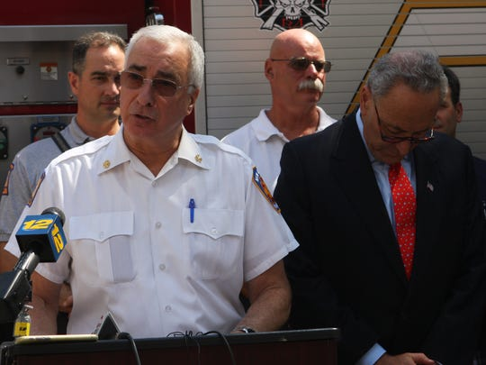 New Rochelle Fire Chief Louis DiMeglio thanks U.S. Sen. Charles Schumer for proposing a national firefighter cancer registry.