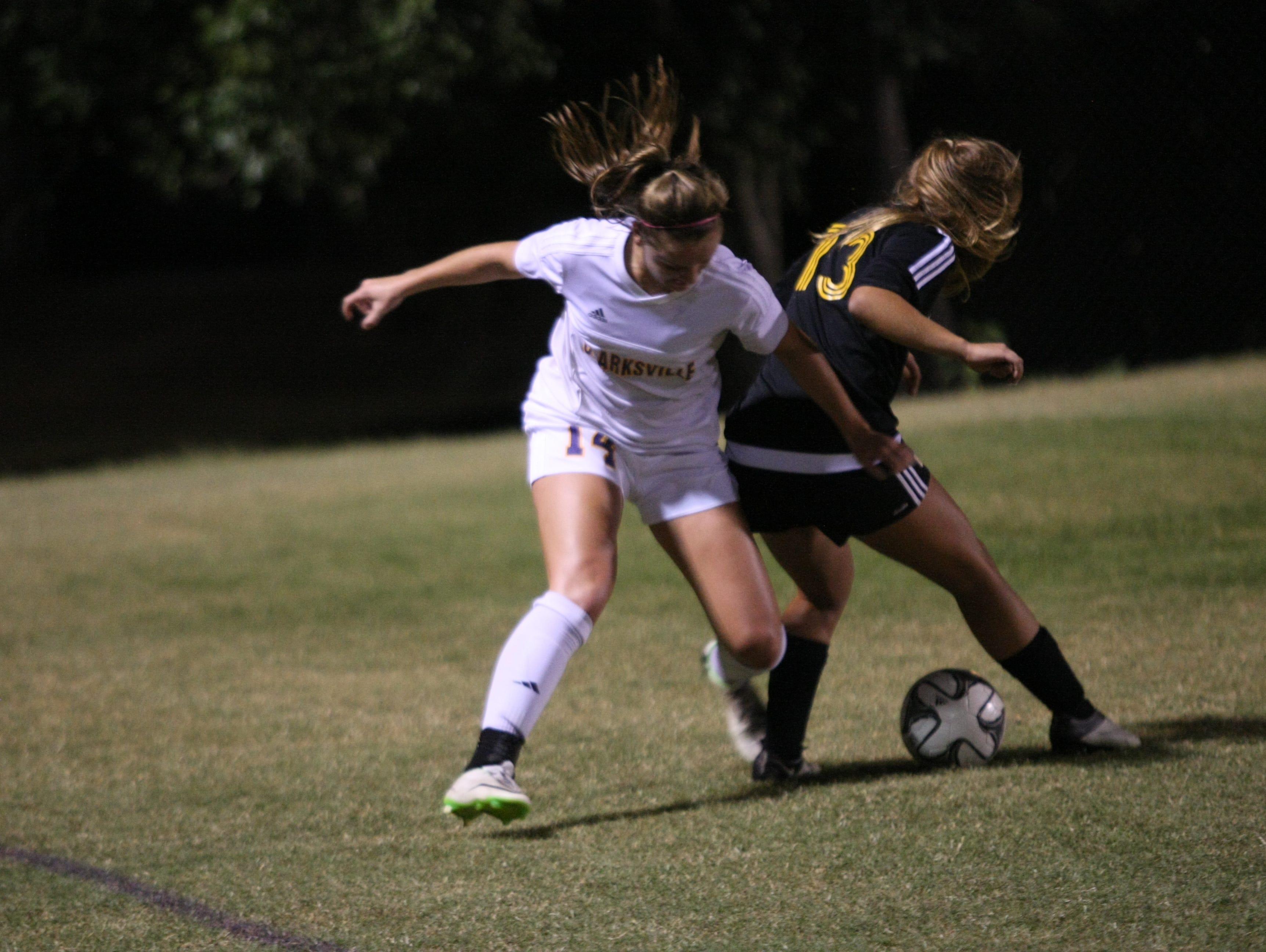 Clarksville senior forward Lexie Hayes battles for possession with Hendersonville senior Jada Campbell during the Region 5-AAA Tournament championship match.