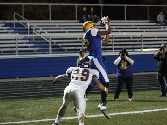 Clyde's Jaylan Johnson catches a touchdown pass against