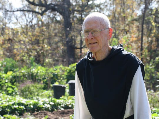Father Cyprian Harrison and the others at Assumption Abbey tend the garden, administer the monastery's guesthouse and produce a staggering 25,000 fruitcakes each year near Ava, Mo.