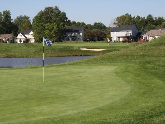 The seventh green in the foreground and eighth green in the background at the Links at Gateway in Romulus.