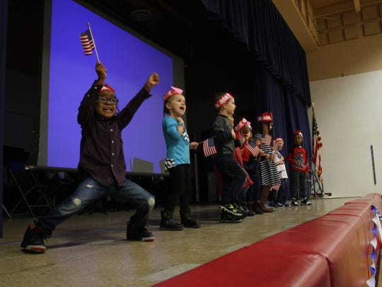 Calvin Coolidge's Pre-K students sing during the Founders' Day Celebration.