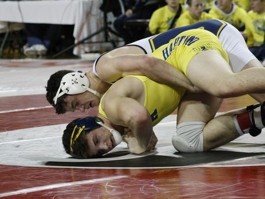 Hartland's Andrew Spisz, below, wrestles with Oxford's Dallas Winkelman during the Division 4 team wrestling semifinals Feb. 24, 2017, in Mt. Pleasant.