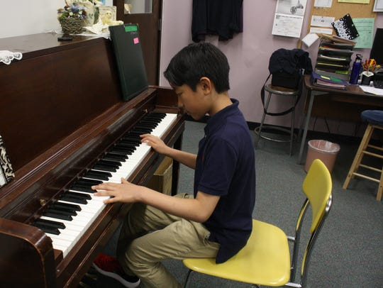 Ian Chung, 11, of Vestal, has been playing piano for