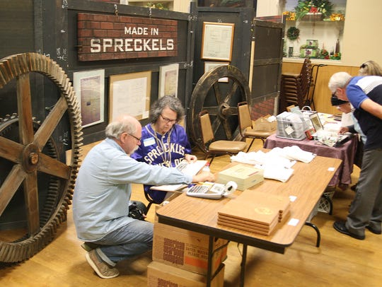 Spreckles Reunion attendees examine historical documents