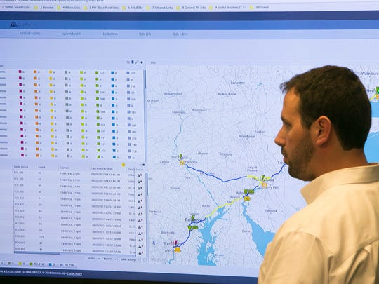 A Siemens employee studies locomotive data being relayed to the company's new East Coast Locomotive Service Hub near New Castle.