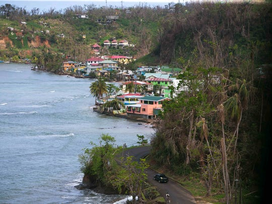 The Delaware Medical Relief Team roll through the village of Calibishie, Dominica on their way to help native islanders in the Carib Territory.