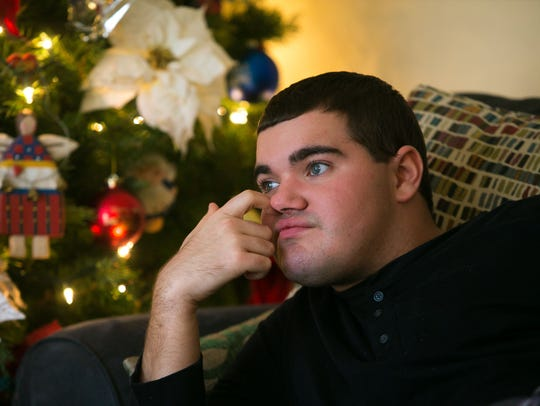 Newark resident Ryan Coleman, who has autism, relaxes
