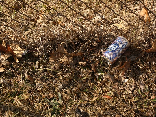 Beer cans and cigarettes littered the yard of the Blind