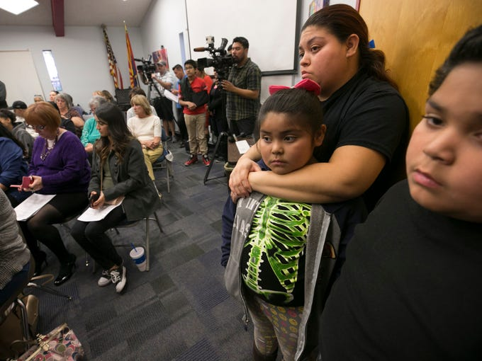 Monica Lopez of Phoenix stands with her daughter Leah