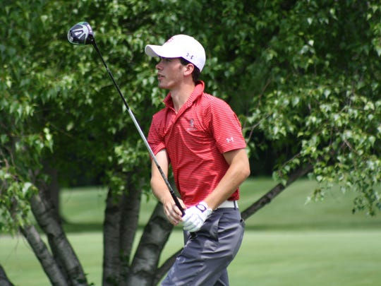 Joey Test of Grosse Ile watches his drive on the 16th