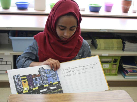 "Tiba Al-Sultani, a fifth grade student at Maine-Endwell's Homer Brink Elementary School, shares her story in her self-penned book, ""My Life."""