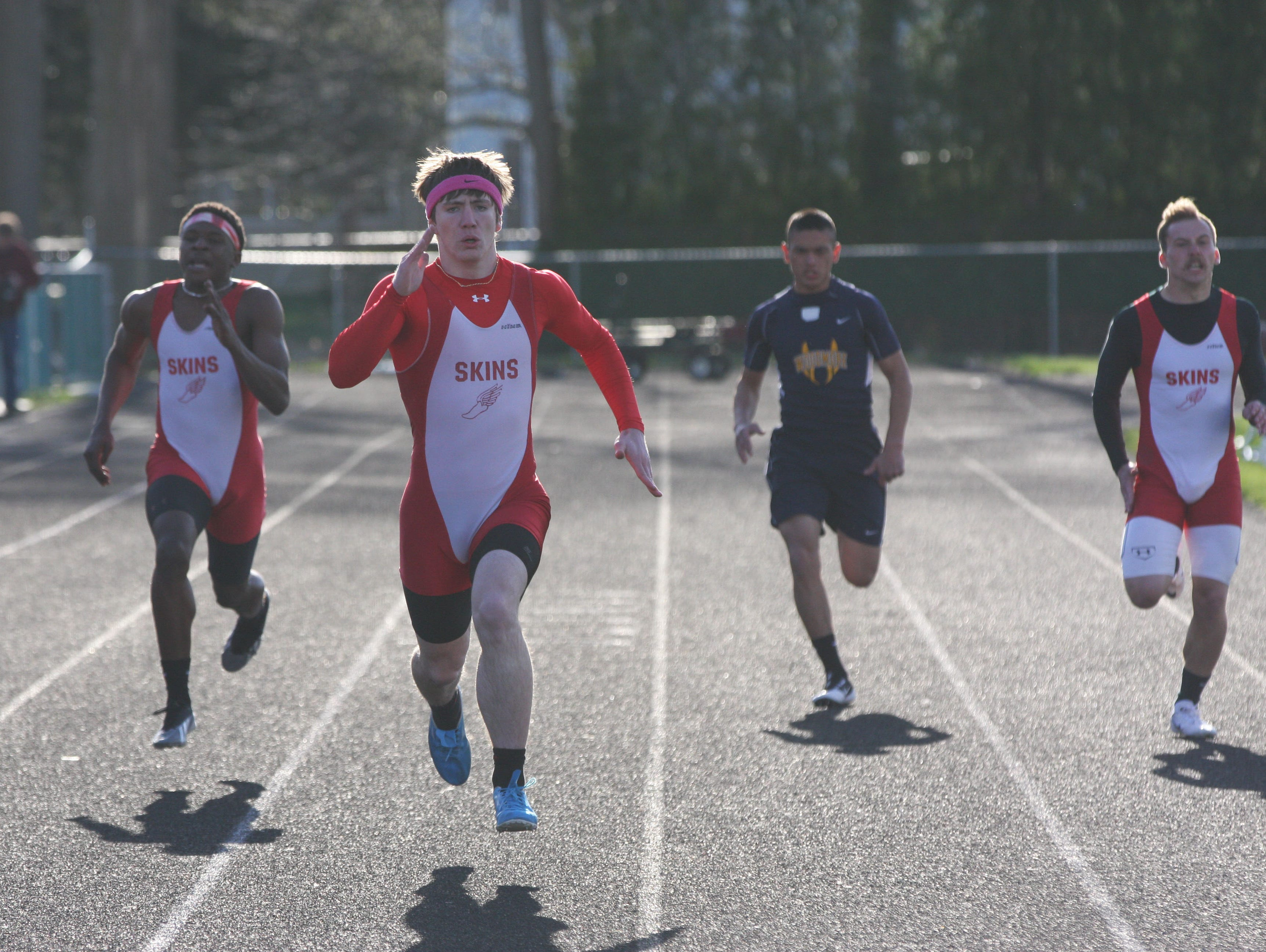 Port Clinton's Brandon Moore leads the field in the 200 meter run.