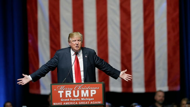 Republican presidential candidate Donald Trump addresses supporters at a campaign rally Monday in Grand Rapids, Mich.