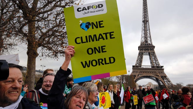 Demonstrators rally in Paris in December 2015 during the U.N. Climate Change Conference, where a pact signed by 180 nations was worked out.