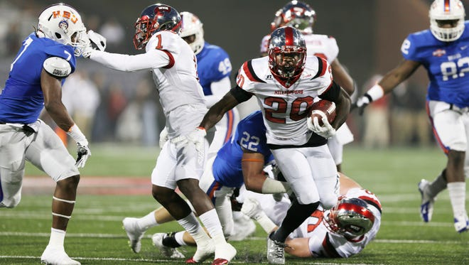 Western Kentucky running back Anthony Wales (20) runs the ball against Houston Baptist during Saturday's game in Bowling Green, Ky.