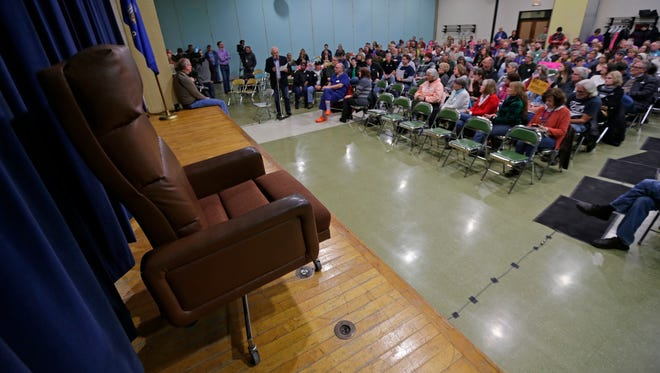 An empty chair is set up for U.S. House Speaker Paul Ryan who was invited but did't attend a town hall set up over the weekend.