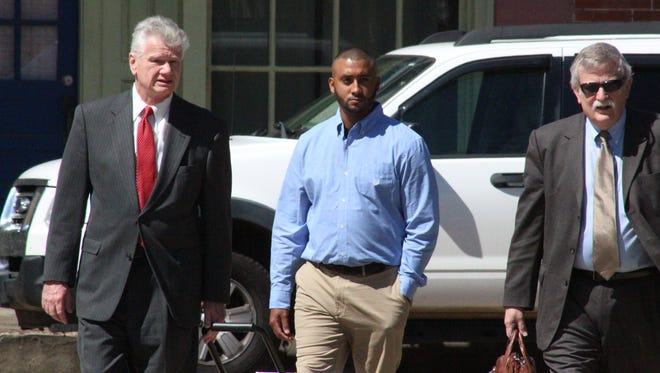 Pineville attorney George Higgins III (left) walks to the Avoyelles Parish Courthouse on Tuesday with Norris Greenhouse Jr. (center), who faces an Oct. 2 trial on second-degree and attempted second-degree murder charges. Alexandria attorney Rocky Willson (right) is assisting Higgins.