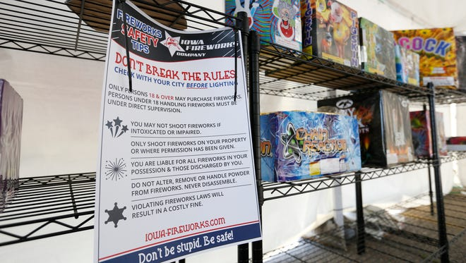 A sign warns customers to use fireworks safely and legally Thursday, June 22, 2017, in Spencer, Iowa.