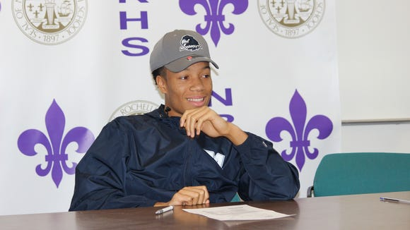 New Rochelle's Romeo Holden signed his National Letter