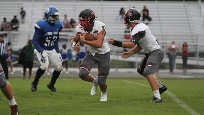 Jupiter Christian School's Shane Sawyer, No. 21, in game action recently.