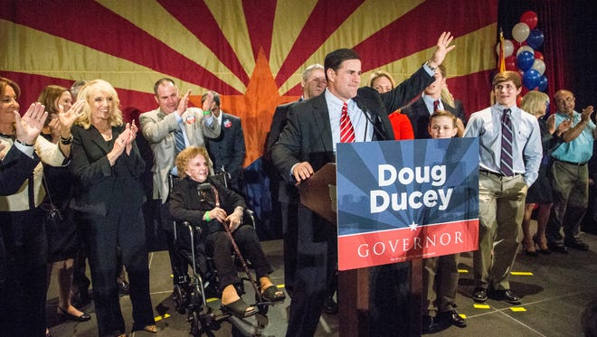 Doug Ducey speaks to supporters who gather to celebrate his victory as governor at the Hyatt hotel in Phoenix on Nov. 4, 2014.