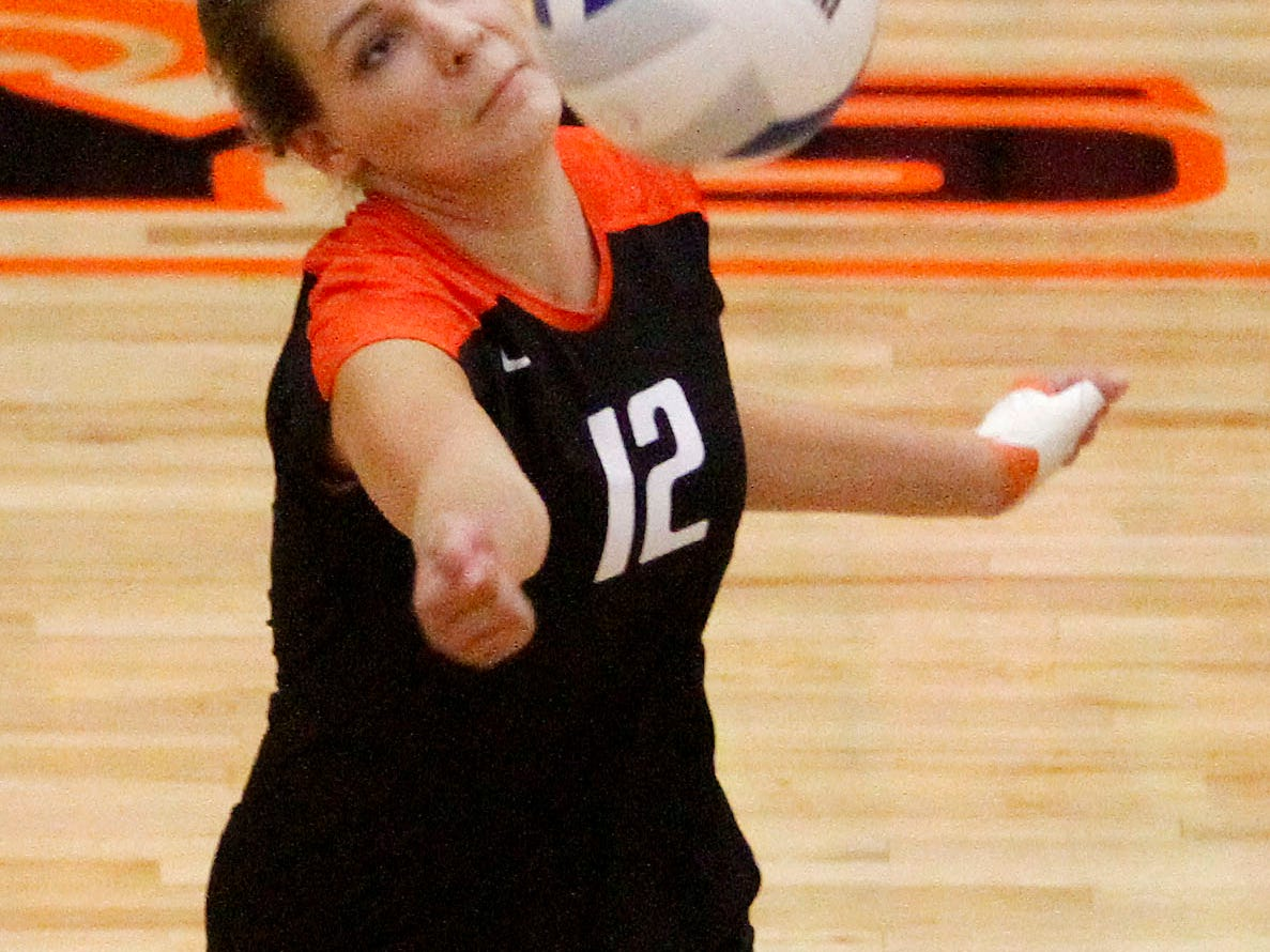 Sprague High School's Riley Mahoney (12) bumps the ball during their game with South Salem on Thursday, Sept. 11, 2014, in Salem, Ore.