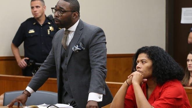 Rochester City Court Judge Leticia Astacio sits with her lawyer, Gregory Salmon, left, during her bail application hearing Wednesday at the Hall of Justice in Rochester.