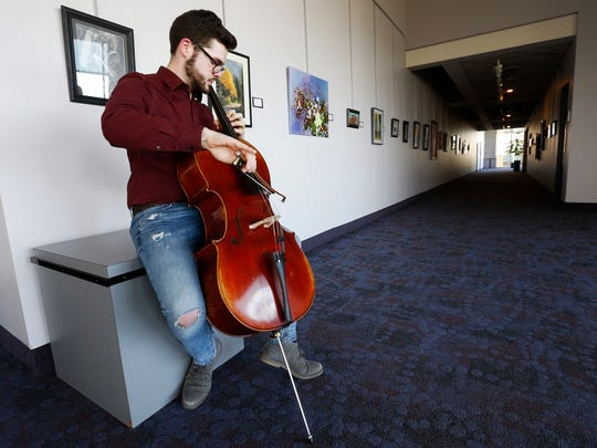 Caleb Marshall practices playing his cello at Hammons