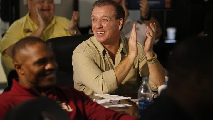 Head coach Jimbo Fisher celebrates on Wednesday morning after a recruit announced on national television he would be attending Florida State.