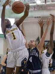 Franklin's Diamond Miller jumps high to pull in a rebound