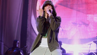 Eminem performs at Samsung Galaxy stage during 2014 Lollapalooza Day One at Grant Park on August 1, 2014 in Chicago.