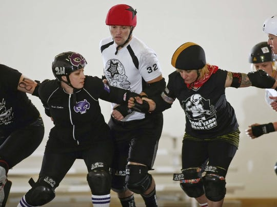 It's girls versus boys during the My Blood Valentine bout on Saturday at The Mad House.