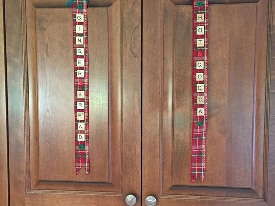 Spruce up your kitchen by using Scrabble letters to make decorative ribbons to hang from the cabinets.