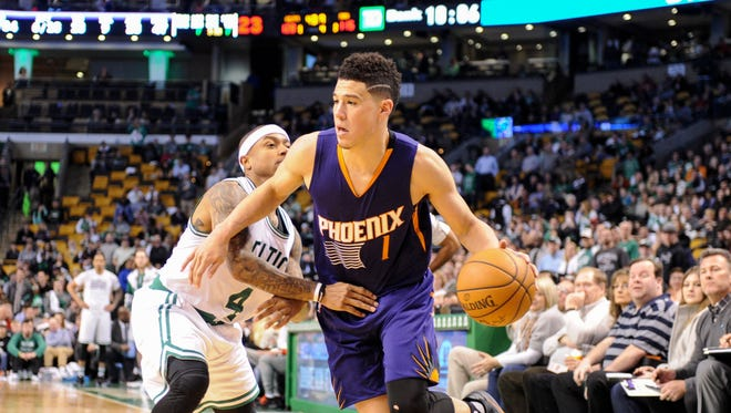 Mar 24, 2017: Phoenix Suns guard Devin Booker (1) controls the ball while Boston Celtics guard Isaiah Thomas (4) defends during the second half at TD Garden.