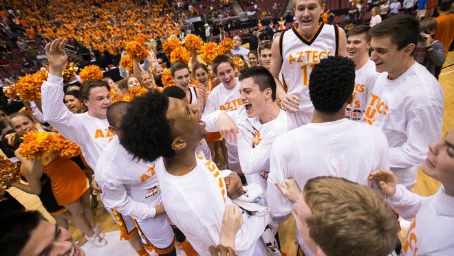 Corona del Sol celebrates after beating Desert Vista in the state title game at Gila River Arena in Glendale, AZ on March 2, 2015.