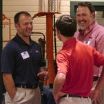 Ross Bjork, The Athletic Director for the University of Mississippi, Ole Miss, was the guest of the Greater Pensacola Ole Miss Club Thursday evening. Ross, shown far left in this photo, is shown getting to know Ole Miss fans Luke Ellis and Luke's father, Ed Ellis.
