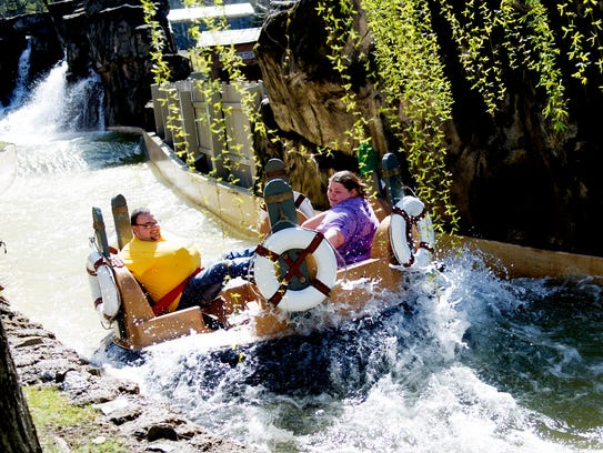Visitors ride Smoky Mountain River Rampage during opening