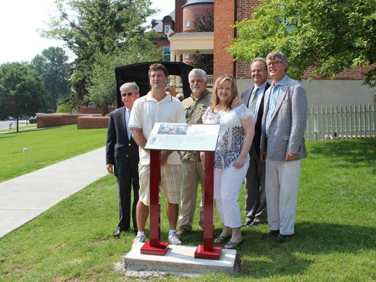 Officials from the Seminary Ridge Historic Preservation Foundation stand in front of a wayside marker donated to the Seminary Ridge Museum on July 1. Pictured from left to write are foundation chairman Em Cole, historian Michael Dreese, marker donors Phil and Amy Spaugy,  executive assistant to the president John Spangler and museum CEO Daryl Black.