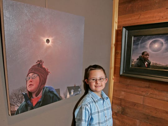 In 2006, Sam Lenz stands near a portrait of himself (left) painted by his father, David Lenz.