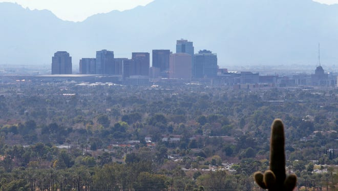 A smoggy haze can be seen over downtown Phoenix on Feb. 5, 2014.
