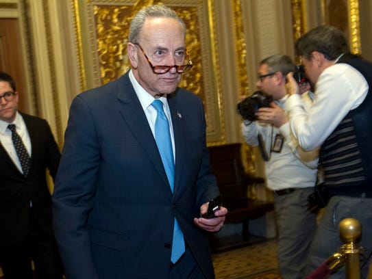 Sen. Charles Schumer, D-N.Y., walks to the chamber
