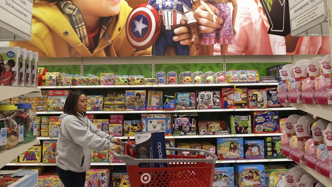 A woman walks through the toy department at a Target store.