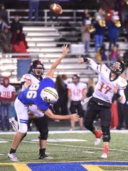 Searcy quarterback Mason Schucker (17) throws a deep pass as Mountain Home's Luke Foreman (86) applies pressure Friday night at Bomber Stadium.